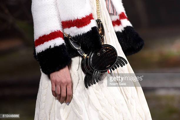A model walks the runway purse detail wearing Thom Browne Fall 2016 during New York Fashion Week The Shows at Skylight Modern on February 15 2016 in...