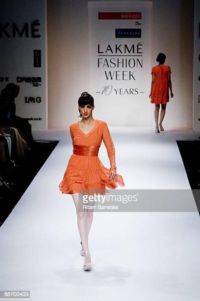A model walks the runway showcasing creations by designer Manish Gupta at The Westside Show presented by Wendell Rodricks Narendra Kumar and Manish...