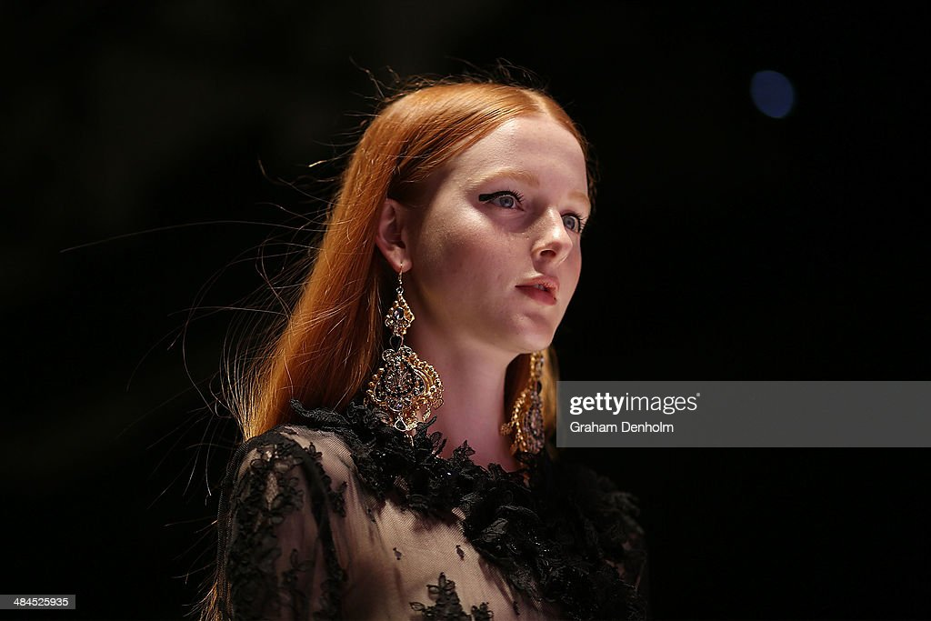 A model walks the runway showcasing designs by Ae'lkmi at the Best of #MBFWA show at Mercedes-Benz Fashion Week Australia - Weekend Edition at Carriageworks on April 13, 2014 in Sydney, Australia.