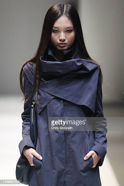 A model walks the runway showcasing designs by Esther Perbrandt at the Audi Fashion Festival Future Fashion Showcase which featured designs by Timo...