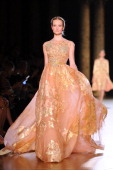 A model walks the runway the Elie Saab HauteCouture show as part of Paris Fashion Week Fall / Winter 2012/13 at Pavillon Cambon Capucines on July 4...