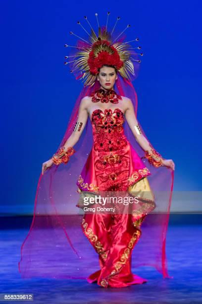 A model walks the runway wearing a Carmelo Andrada design at the Metropolitan Fashion Week Closing Night Gala at Arcadia Performing Arts Center on...