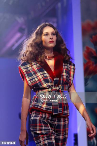 A model walks the runway wearing a creation by Philippe Perisse during the 10th '48h Maisons De Mode' fashion show on September 15 2017 in Lille...