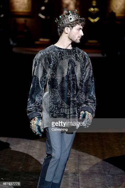 A model walks the runway wearing a crown at the Dolce and Gabbana Autumn Winter 2014 fashion show during Milan Menswear Fashion Week on January 11...