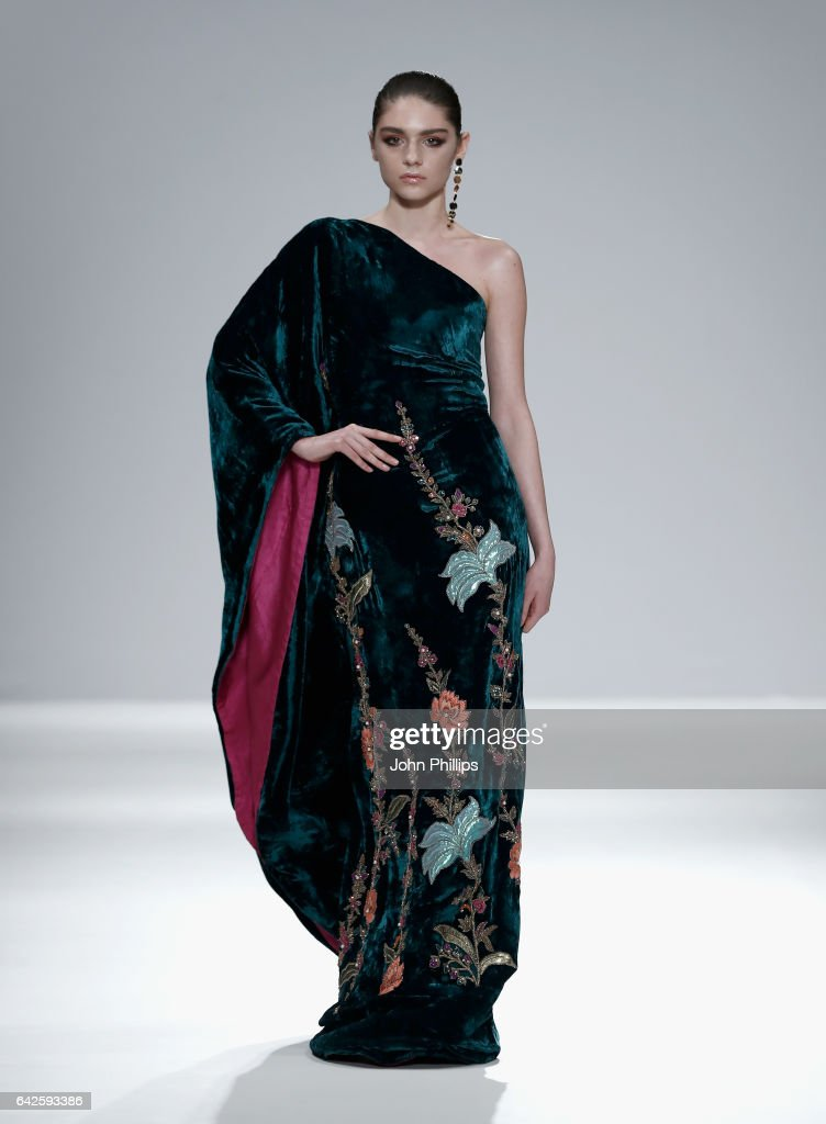 model-walks-the-runway-wearing-a-design-by-jeem-at-the-fashion-dna-picture-id642593386