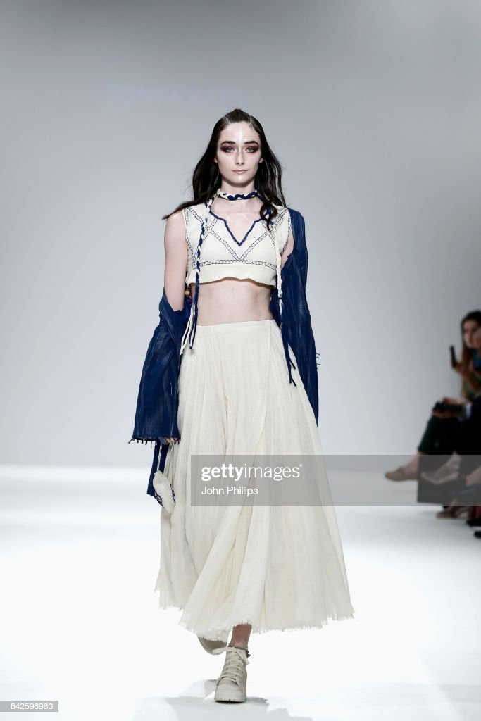 model-walks-the-runway-wearing-a-design-by-sonya-battla-at-the-dna-picture-id642596980