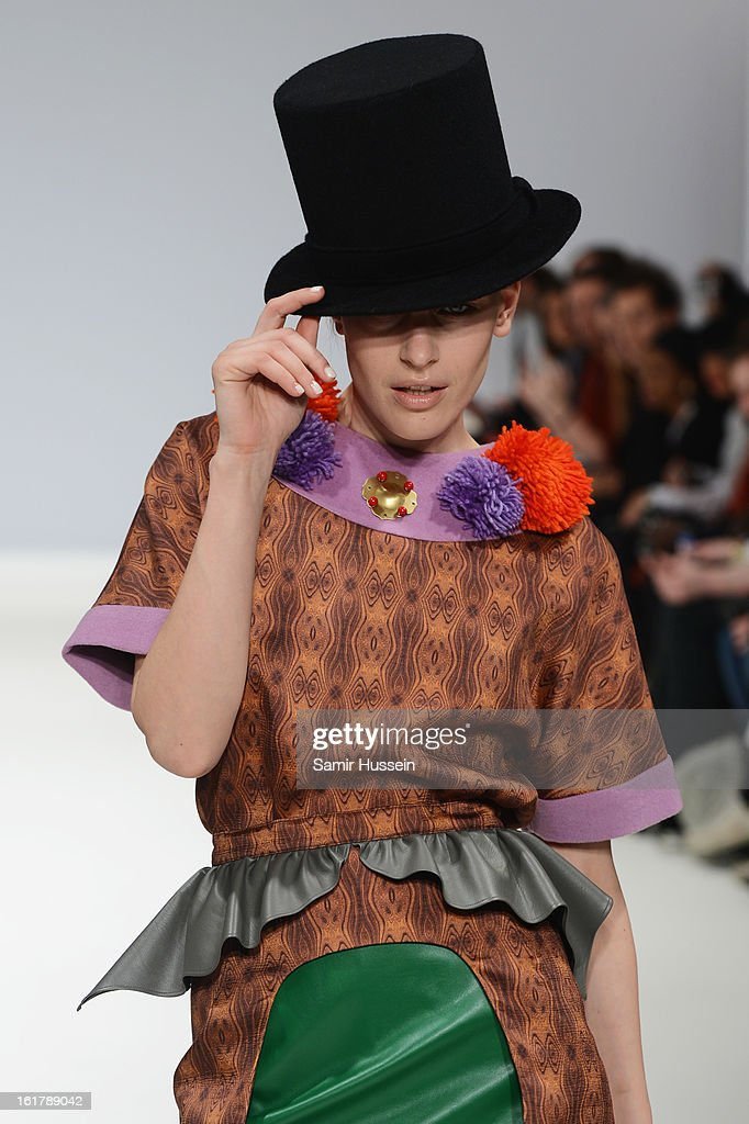 A model walks the runway wearing a design by Yeashin Kim at the Ones To Watch show during London Fashion Week Fall/Winter 2013/14 at Freemasons Hall on February 16, 2013 in London, England.