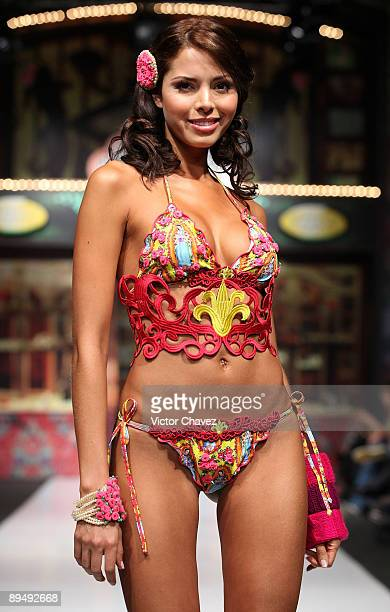 A model walks the runway wearing Agua Bendita during the second day of Colombia Moda 2009 at Plaza Mayor on July 28 2009 in Medellin Colombia