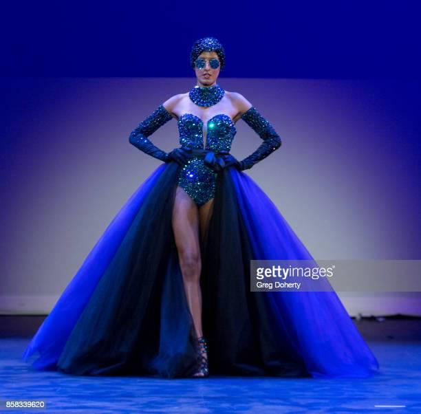 A model walks the runway wearing an Emil Gampe design at the Metropolitan Fashion Week Closing Night Gala at Arcadia Performing Arts Center on...