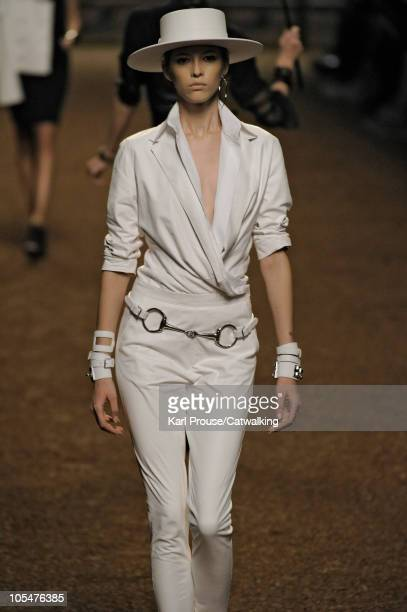 A model walks the runway wearing and equestrian ensemble at the Hermes fashion show during Paris Fashion Week on October 6 2010 in Paris City