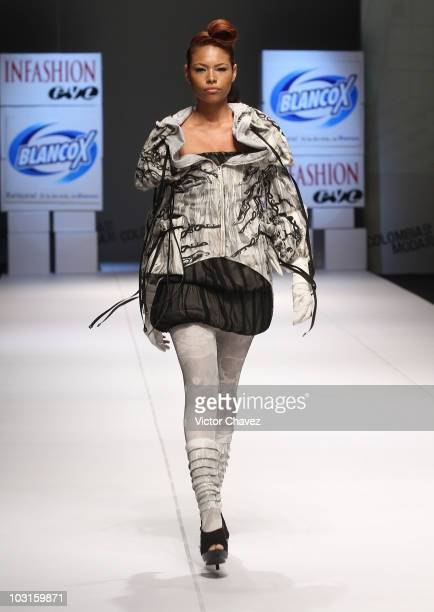 A model walks the runway wearing Andres Lopera during Colombiamoda 2010 at Plaza Mayor on July 27 2010 in Medellin Colombia