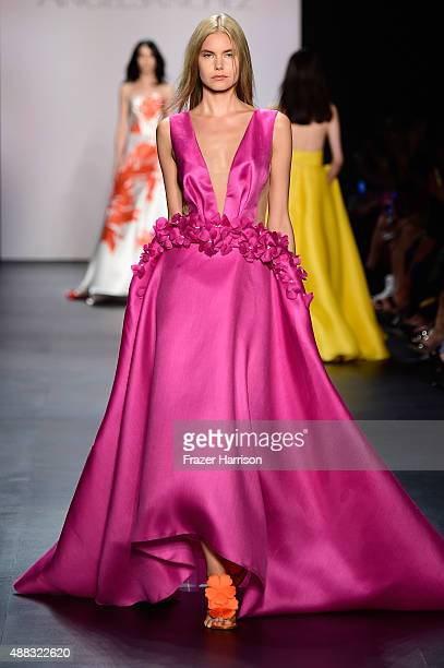 A model walks the runway wearing Angel Sanchez Spring 2016 during New York Fashion Week The Shows at The Dock Skylight at Moynihan Station on...