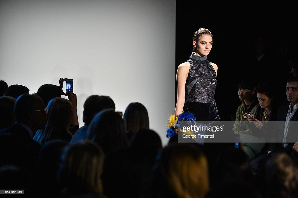 A model walks the runway wearing Ashtiani fall 2013 collection during World MasterCard Fashion Week Fall 2013 at David Pecaut Square on March 20, 2013 in Toronto, Canada.