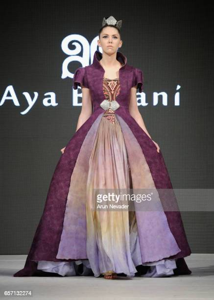 A model walks the runway wearing at Vancouver Fashion Week Fall/Winter 2017 at Chinese Cultural Centre of Greater Vancouver on March 23 2017 in...