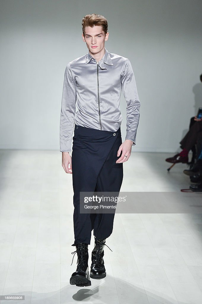A model walks the runway wearing Axel K spring 2014 collection during World MasterCard Fashion Week Spring 2014 at David Pecaut Square on October 23, 2013 in Toronto, Canada.