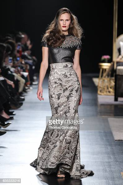 A model walks the runway wearing Badgley Mischka during New York Fashion Week at Gallery 1 Skylight Clarkson Sq on February 14 2017 in New York City