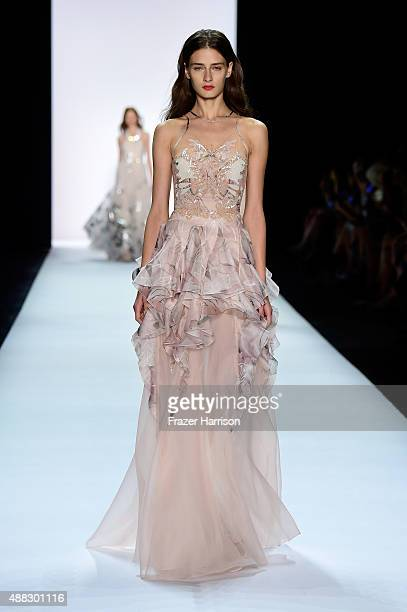 A model walks the runway wearing Badgley Mischka Spring 2016 during New York Fashion Week The Shows at The Arc Skylight at Moynihan Station on...