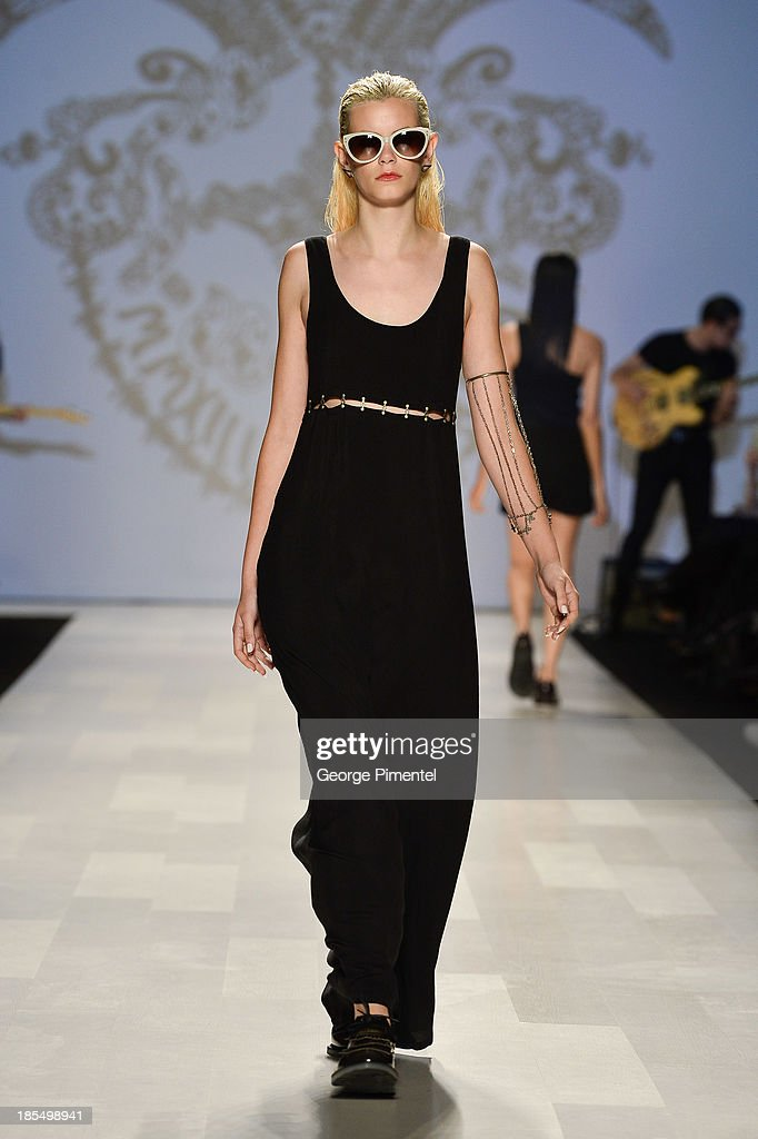 A model walks the runway wearing Beaufille spring 2014 collection during World MasterCard Fashion Week Spring 2014 at David Pecaut Square on October 21, 2013 in Toronto, Canada.