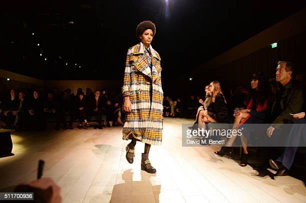A model walks the runway wearing Burberry at the Burberry Womenswear February 2016 Show at Kensington Gardens on February 22 2016 in London England