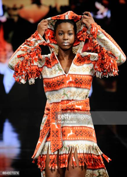 A model walks the runway wearing Burning Guitars Gear at Art Hearts Fashion LAFW Fall/Winter 2017 Day 3 at The Beverly Hilton Hotel on March 16 2017...
