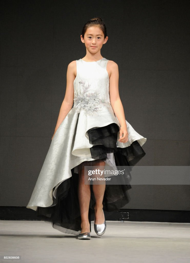 A model walks the runway wearing Cabriolle at 2017 Vancouver Fashion Week - Day 6 on September 23, 2017 in Vancouver, Canada.