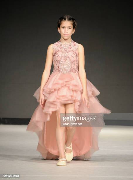 A model walks the runway wearing Cabriolle at 2017 Vancouver Fashion Week Day 6 on September 23 2017 in Vancouver Canada