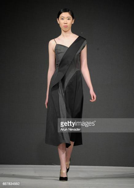 A model walks the runway wearing Carolina Ferioli at Vancouver Fashion Week Fall/Winter 2017 at Chinese Cultural Centre of Greater Vancouver on March...