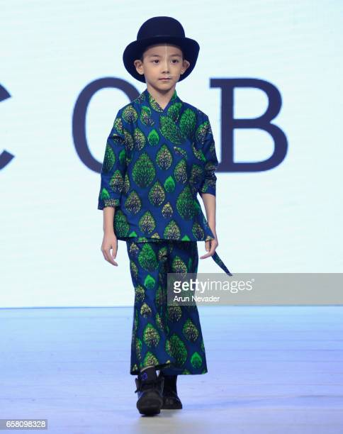 A model walks the runway wearing Celestin Jacobin at Vancouver Fashion Week Fall/Winter 2017 at Chinese Cultural Centre of Greater Vancouver on March...
