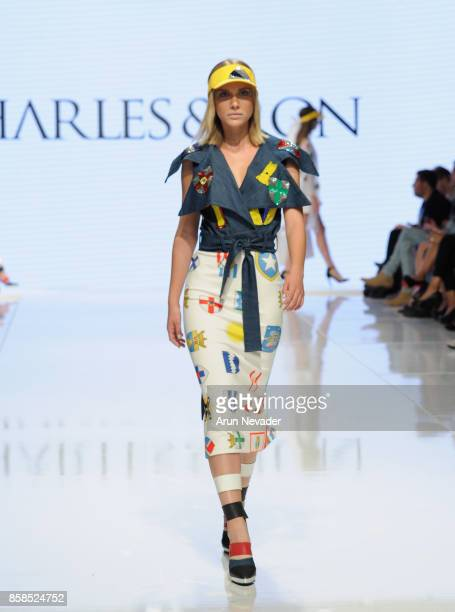 A model walks the runway wearing Charles and Ron at Los Angeles Fashion Week SS18 Art Hearts Fashion LAFW on October 6 2017 in Los Angeles California