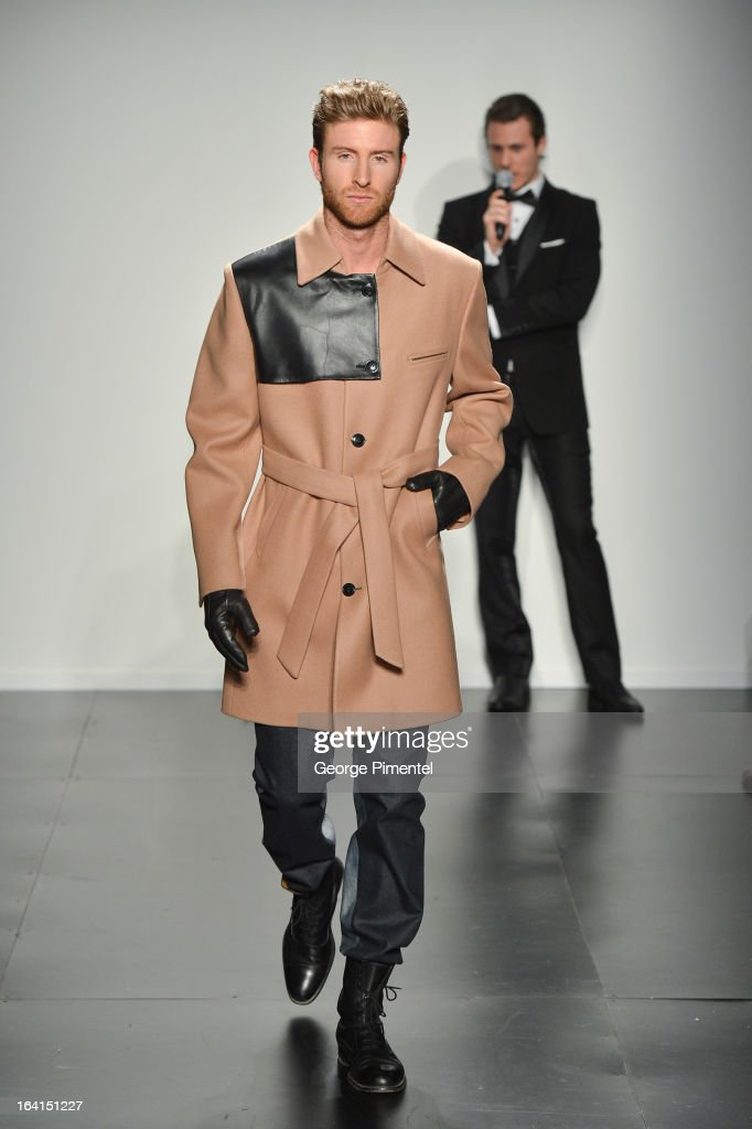 A model walks the runway wearing Christoper Bates fall 2013 collection during World MasterCard Fashion Week Fall 2013 at David Pecaut Square on March 20, 2013 in Toronto, Canada.