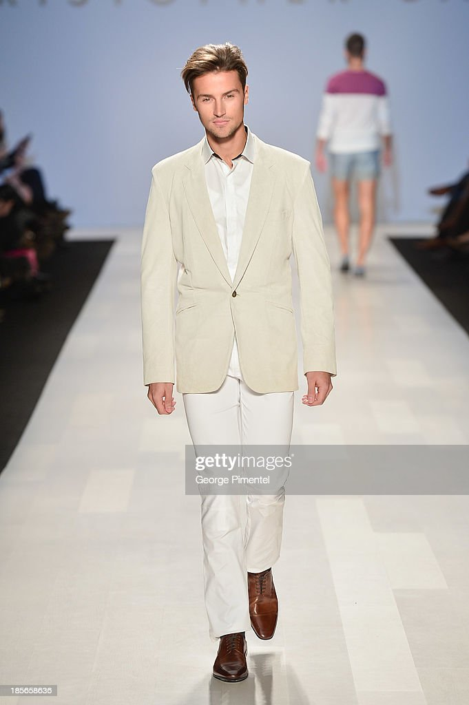 A model walks the runway wearing Christopher Bates spring 2014 collection during World MasterCard Fashion Week Spring 2014 at David Pecaut Square on October 23, 2013 in Toronto, Canada.