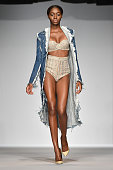A model walks the runway wearing clothes from fashion designer Laquan Smith during The Gold and White Fashion Gala at Summer Sizzle British Virgin...