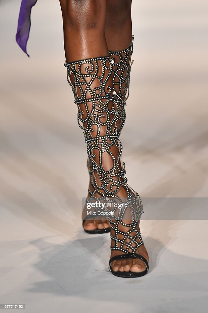 A model walks the runway wearing clothes from fashion designer Roger Gary during The Gold and White Fashion Gala at Summer Sizzle British Virgin...
