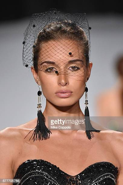 A model walks the runway wearing clothes from fashion designer Yumi Katura during The Gold and White Fashion Gala at Summer Sizzle British Virgin...
