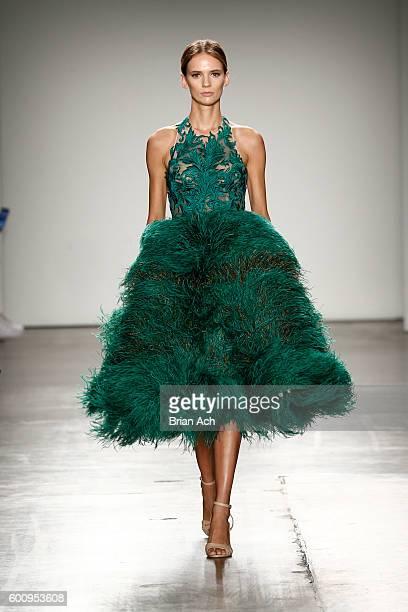 A model walks the runway wearing CON ILIO at Fashion Palette Australian Womenswear New York Fashion Week Spring/Summer 2017 at Pier 59 Studios on...