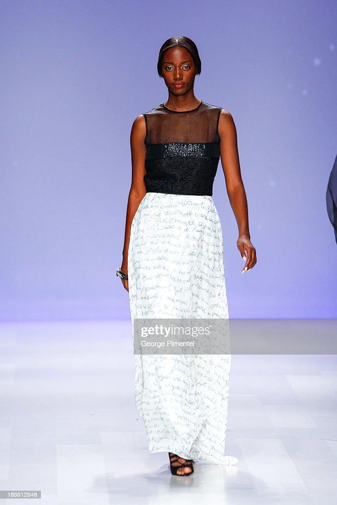 A model walks the runway wearing David Dixon spring 2014 collection during World MasterCard Fashion Week Spring 2014 at David Pecaut SquareÊon October 21, 2013 in Toronto, Canada.