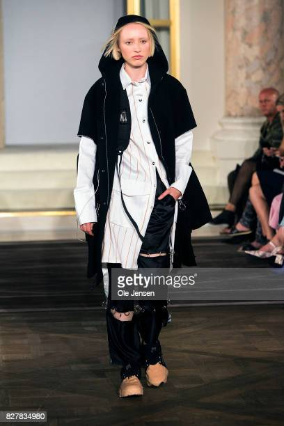 A model walks the runway wearing design by Anders Poulsen at the 'Designer's Nest' award show Copenhagen Fashion Week Spring/Summer 2018 on August 8...