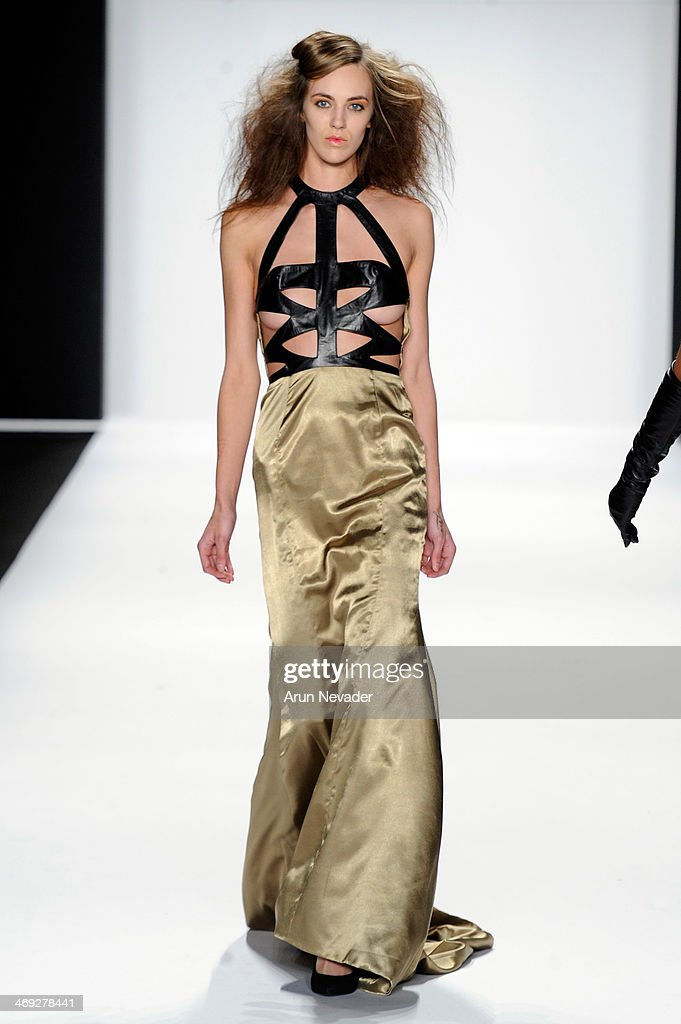 A model walks the runway wearing designer Altaf Maaneshia at the FLT Moda + Art Hearts Fashion show presented by AIDS Healthcare Foundation during Mercedes-Benz Fashion Week Fall 2014 on February 13, 2014 in New York City.