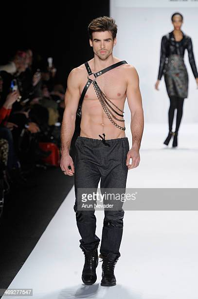 A model walks the runway wearing designer Erik 'Mister Triple X' Rosete at the FLT Moda Art Hearts Fashion show presented by AIDS Healthcare...