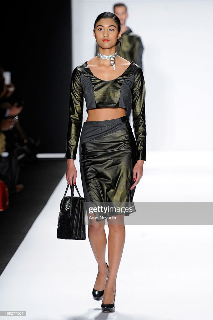 A model walks the runway wearing designer Erik 'Mister Triple X' Rosete at the FLT Moda + Art Hearts Fashion show presented by AIDS Healthcare Foundation during Mercedes-Benz Fashion Week Fall 2014 at The Theatre at Lincoln Center on February 13, 2014 in New York City.