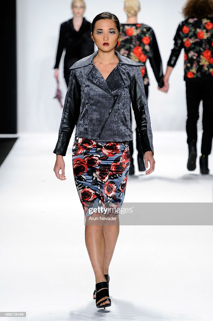 A model walks the runway wearing designer Erik 'Mister Triple X' Rosete at the FLT Moda + Art Hearts Fashion show presented by AIDS Healthcare Foundation during Mercedes-Benz Fashion Week Fall 2014 on February 13, 2014 in New York City.