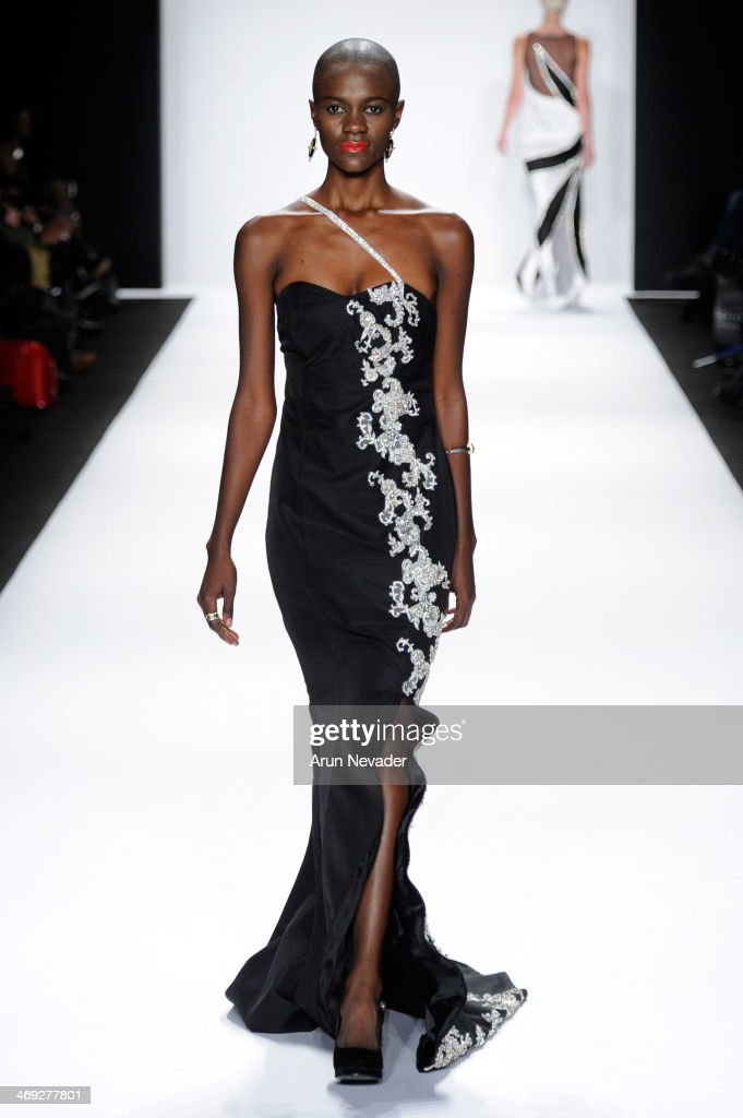 A model walks the runway wearing designer Gianni Tolentino at the FLT Moda + Art Hearts Fashion show presented by AIDS Healthcare Foundation during Mercedes-Benz Fashion Week Fall 2014 at The Theatre at Lincoln Center on February 13, 2014 in New York City.