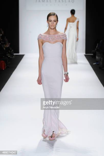 A model walks the runway wearing designer Jamal Taslaq at the FLT Moda Art Hearts Fashion show presented by AIDS Healthcare Foundation during...