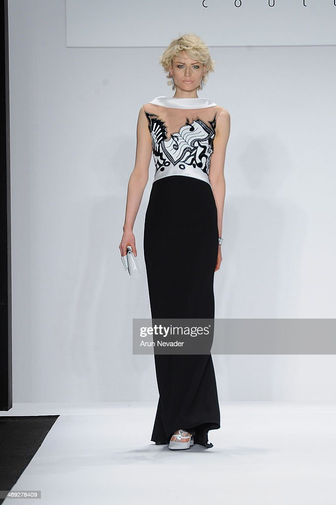 A model walks the runway wearing designer Jamal Taslaq at the FLT Moda + Art Hearts Fashion show presented by AIDS Healthcare Foundation during Mercedes-Benz Fashion Week Fall 2014 on February 13, 2014 in New York City.