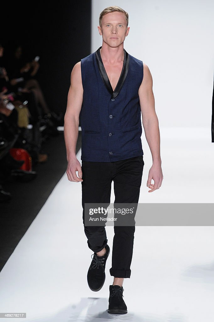 A model walks the runway wearing designer M The Movementat the FLT Moda + Art Hearts Fashion show presented by AIDS Healthcare Foundation during Mercedes-Benz Fashion Week Fall 2014 at The Theatre at Lincoln Center on February 13, 2014 in New York City.