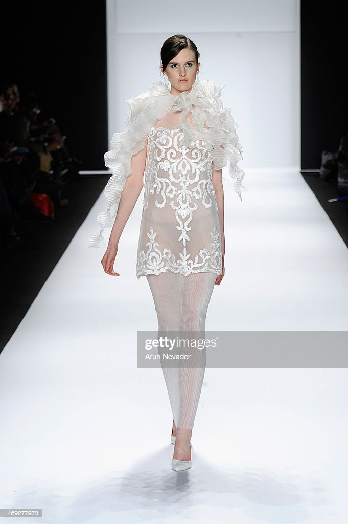 A model walks the runway wearing designer Nino Lettieri at the FLT Moda + Art Hearts Fashion show presented by AIDS Healthcare Foundation during Mercedes-Benz Fashion Week Fall 2014 at The Theatre at Lincoln Center on February 13, 2014 in New York City.