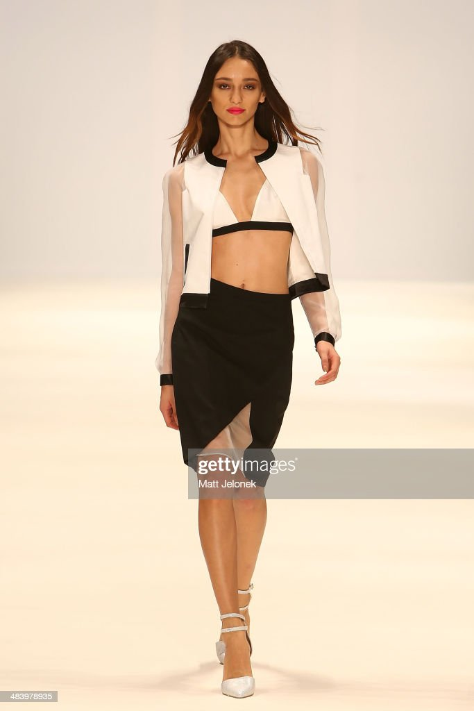 A model walks the runway wearing designs by Anna Quan at the New Generation show at Mercedes-Benz Fashion Week Australia 2014 on April 10, 2014 in Sydney, Australia.