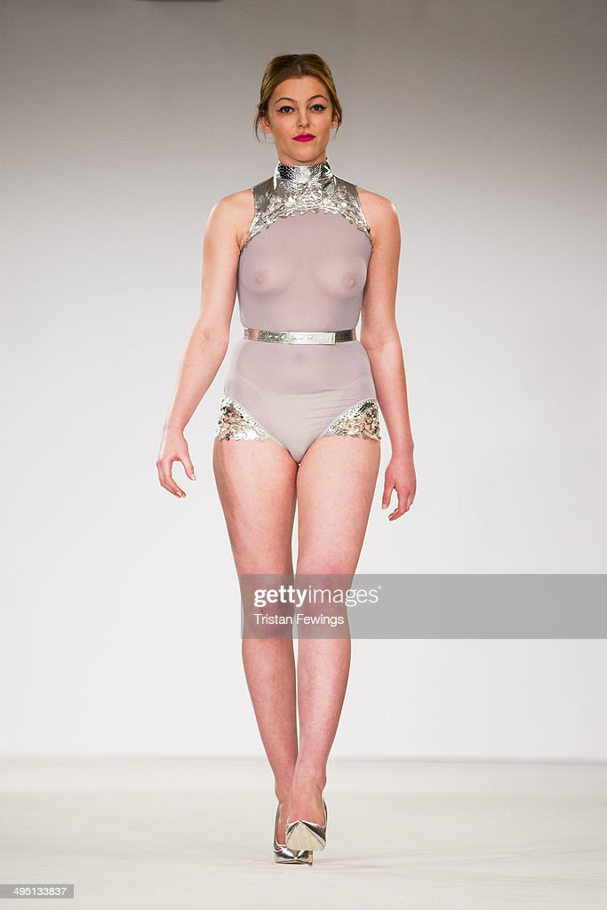 A model walks the runway wearing designs by Charlotte Jane Spence during the De Montfort Contour show during day 2 of Graduate Fashion Week 2014 at The Old Truman Brewery on June 1, 2014 in London, England.
