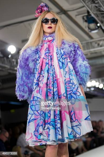 A model walks the runway wearing designs by Emma Bridge during the University of Northampton show during day 3 of Graduate Fashion Week 2014 at The...