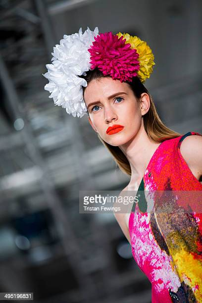 A model walks the runway wearing designs by Emma Rahman during the Wiltshire College Salisbury show during day 2 of Graduate Fashion Week 2014 at The...